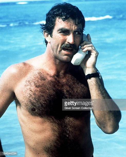 American actor Tom Selleck as Thomas Magnum making a mobile phone call from the beach in the American TV series 'Magnum PI' circa 1985