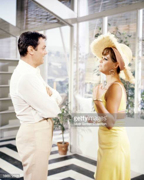 American actor Tony Curtis as Carlo Cofield and Italian actress Claudia Cardinale as Laura Califatti in a publicity still for 'Don't Make Waves'...
