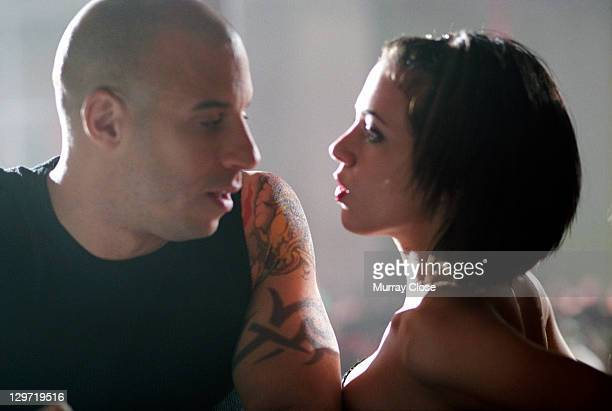 American actor Vin Diesel as Xander Cage and Italian actress Asia Argento as Yelena in a scene from the film 'xXx' 2002