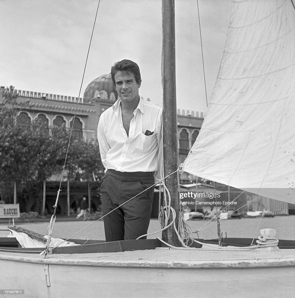 American actor Warren Beatty portrayed while standing on a sail boat on the Lido beach in front of the Excelsior Hotel Lido Venice 1956