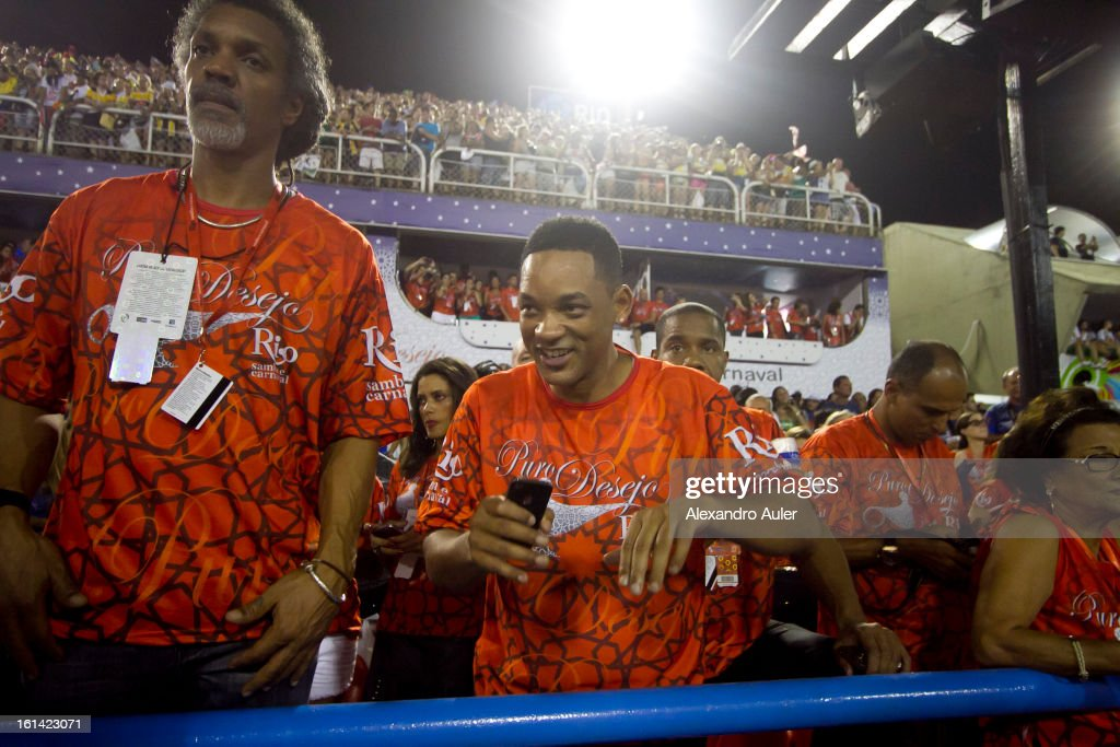 American actor Will Smith enjoys carnival as he watches Salgueiro Samba School perfomance as part of the 2013 Brazilian Carnival at Sapucaí Smbodrome on February 10; 2013 in Rio de Janeiro; Brazil. Rio's two nights of Carnival parades began on February 10 in a burst of fireworks and to the cheers of thousands of turists and locals who have previously enjoyed Street celebrations (known as Blocos de rua) all around the city.
