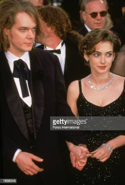 American actor Winona Ryder and her date Dave Pirner lead singer of the band Soul Asylum arrive for the Academy Awards Los Angeles California 1995...