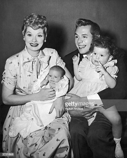 American actors and comedian Lucille Ball and her husband Cubanborn actor and bandleader Desi Arnaz laugh and smile while holding their two children...