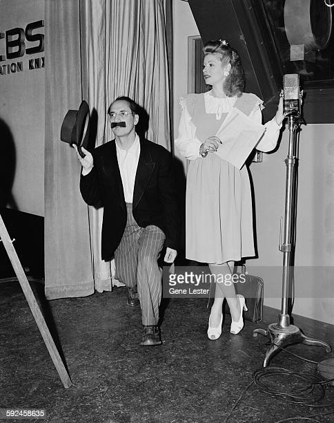 American actors and comedians Groucho Marx and Lucille Ball clown about at CBS's KNX radio studios Los Angeles California October 1945 At the time...