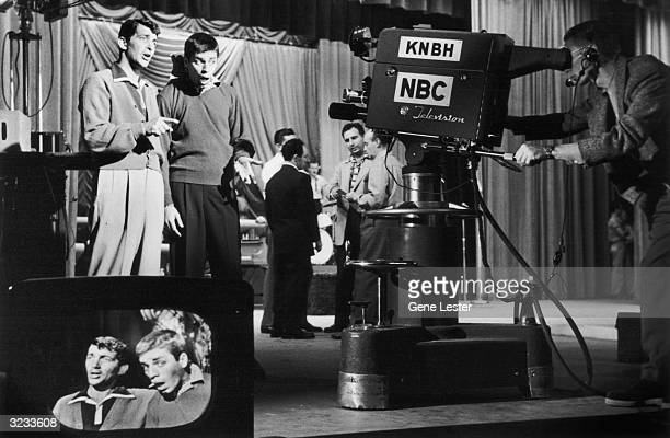 American actors and comedy team Dean Martin and Jerry Lewis perform before a camera on the NBC show 'Martin and Lewis' A television monitor...