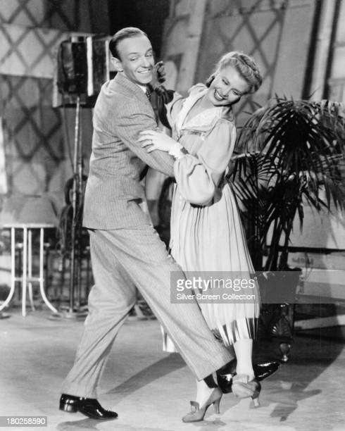 American actors and dancers Fred Astaire and Ginger Rogers in a publicity still for 'Top Hat' directed by Mark Sandrich 1935
