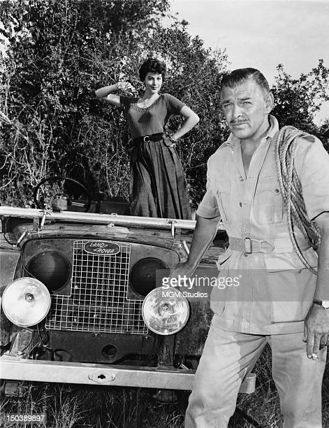 American actors Ava Gardner and Clark Gable pose by their Land Rover during the filming of 'Mogambo' 1953