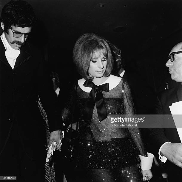 American actors Barbra Streisand and Elliott Gould attend the Academy Awards ceremony at the Dorothy Chandler Pavilion of the LA County Music Center...