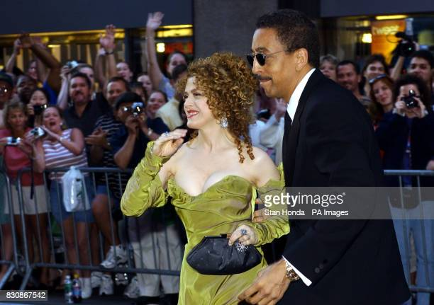 American actors Bernadette Peters and Gregory Hines are cheered by fans as they arrive at the 2002 Tony Awards at Radio City Music Hall in New York...