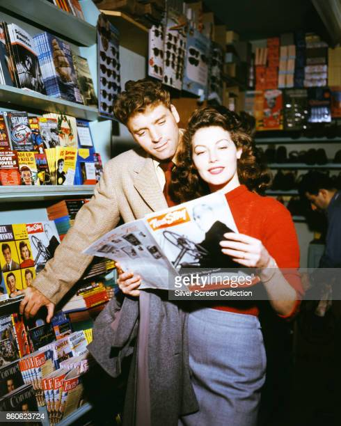 American actors Burt Lancaster and Ava Gardner read a magazine in a newstand on the set of 'The Killers' Universal City California 1946