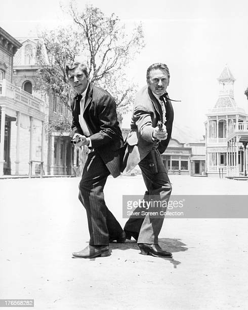 American actors Burt Lancaster as Wyatt Earp and Kirk Douglas as Doc Holliday in a publicity still for 'Gunfight At The OK Corral' directed by John...