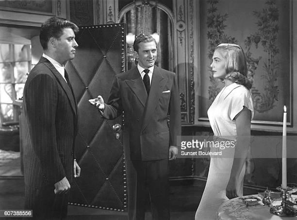 American actors Burt Lancaster Kirk Douglas and Lizabeth Scott on the set of I Walk Alone directed by Byron Haskin
