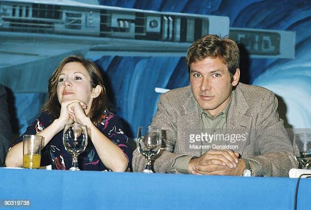American actors Carrie Fisher and Harrison Ford at a press conference for one of the 'Star Wars' films circa 1980