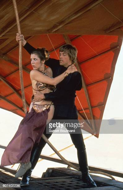 American actors Carrie Fisher and Mark Hamill on the set of Star Wars Episode VI Return of the Jedi directed by Welsh Richard Marquand