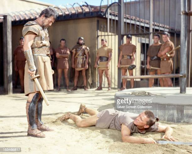 American actors Charles McGraw as the gladiator trainer Marcellus and Kirk Douglas as the Thracian slave Spartacus in 'Spartacus' directed by Stanley...