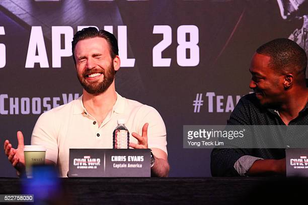 American actors Chris Evans and Anthony Mackie share a laugh during the Southeast Asia press conference of Marvel's 'Captain America Civil War' at...