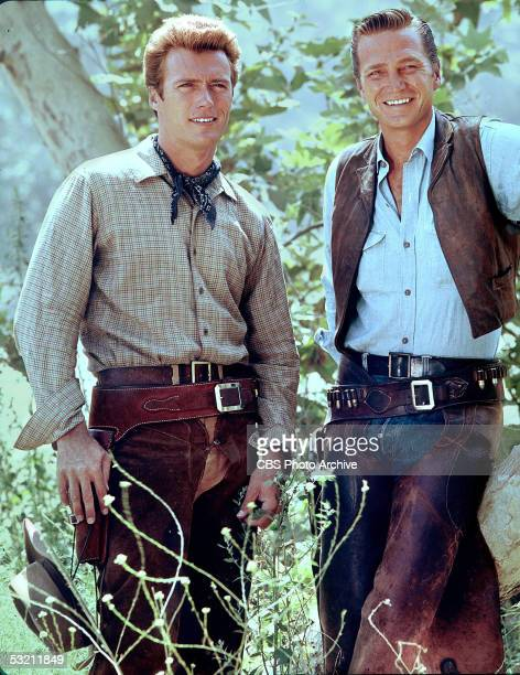 American actors Clint Eastwood and Eric Fleming pose for a portrait on the set of the television series 'Rawhide' 1963