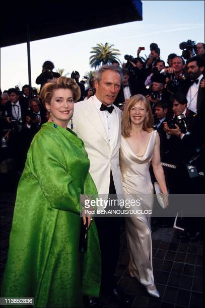 Actress Catherine Deneuve film director Clint Eastwood and his wife at the opening of Cannes Film Festival in Cannes France on May 12 1994