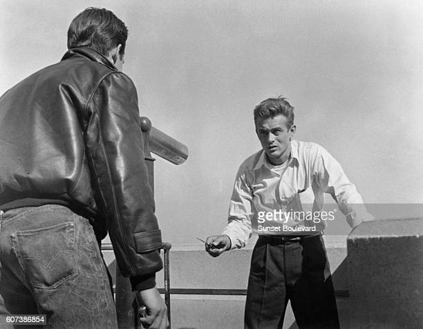 American actors Corey Allen and James Dean on the set of Rebel Without a Cause directed by Nicholas Ray
