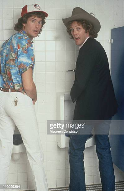 American actors David Hasselhoff and Wings Hauser are surprised at the urinals circa 1980 They are both stars of the television soap opera 'The Young...