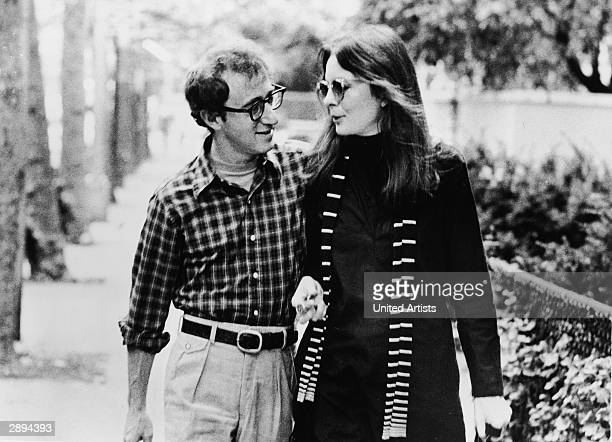 American actors Diane Keaton and Woody Allen walk along a street and talk in a scene from 'Annie Hall' directed by Allen New York New York 1977