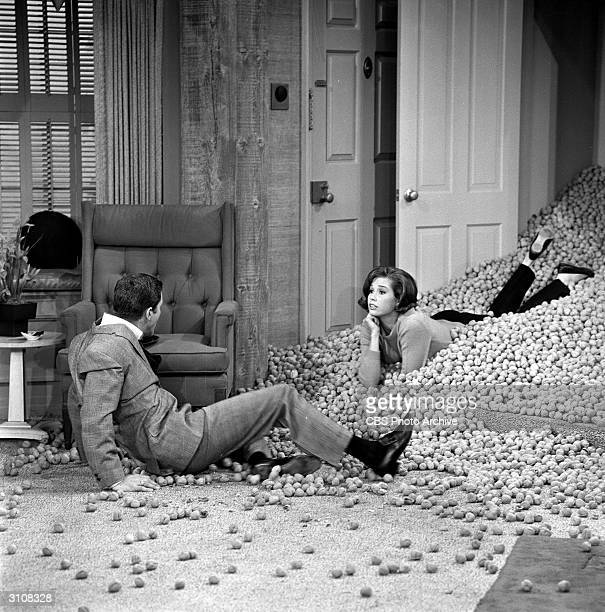 American actors Dick Van Dyke Mary Tyler Moore who play married couple Rob and Laura Petrie appear in a scene from the 'It May Look Like a Walnut'...