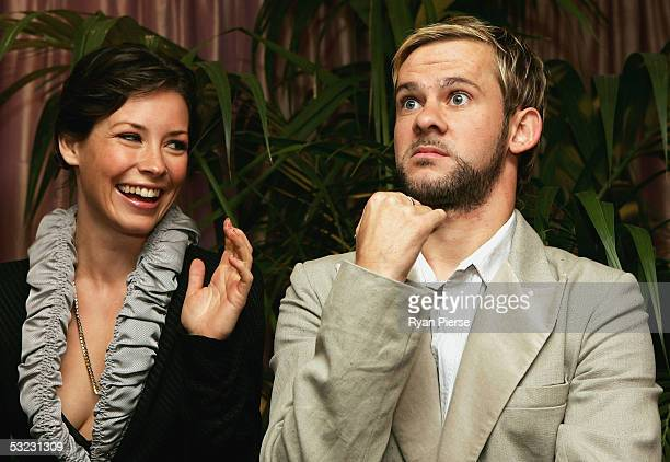 American Actors Dominic Monaghan and Evangeline Lilly from 'Lost' TV show pose during the 'Lost'' Media Party at The Prince Hotel on July 13 2005 in...
