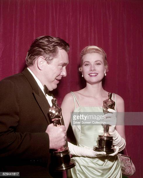 American actors Edmond O'Brien and Grace Kelly with their Oscars at the 27th Academy Awards ceremony held at the RKO Pantages Theatre in Hollywood...