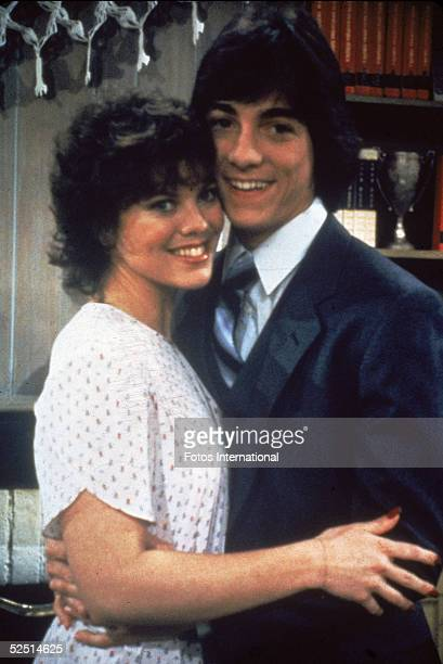 American actors Erin Moran and Scott Baio hold each other in a publicity still for the television show 'Joanie Loves Chachi' in which they play the...