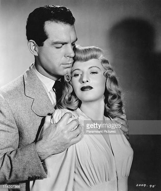 American actors Fred MacMurray and Barbara Stanwyck in a publicity still for 'Double Indemnity' directed by Billy Wilder 1944