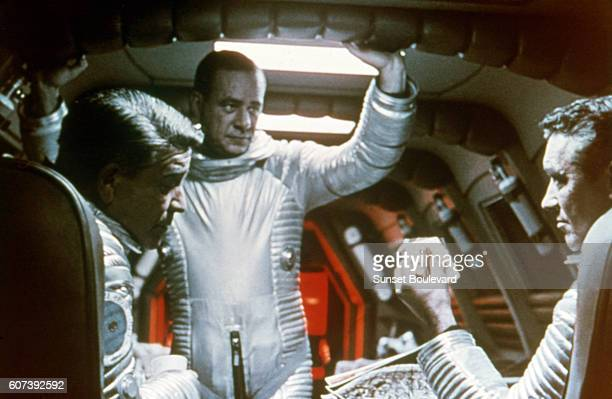 American actors Gary Lockwood William Sylvester and Keir Dullea on the set of 2001 A Space Odyssey written and directed by Stanley Kubrick