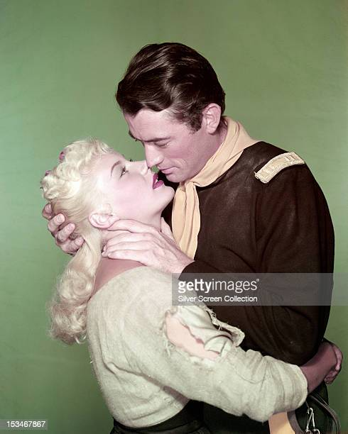 American actors Gregory Peck and Barbara Payton kiss in a publicity still for 'Only the Valiant' directed by Gordon Douglas 1951