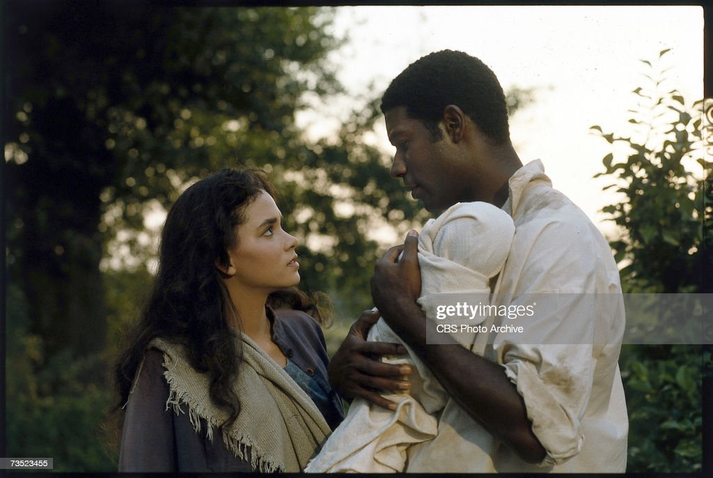 American actors Halle Berry (left) and Dennis Haysbert appear in a scene from the television mini-series 'Queen,' directed by John Erman, in which Berry plays the title character, South Carolina, 1993.