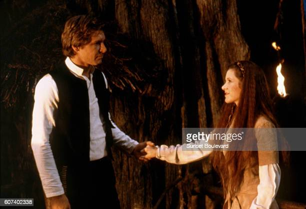American actors Harrison Ford and Carrie Fisher on the set of Star Wars Episode VI Return of the Jedi directed by Welsh Richard Marquand