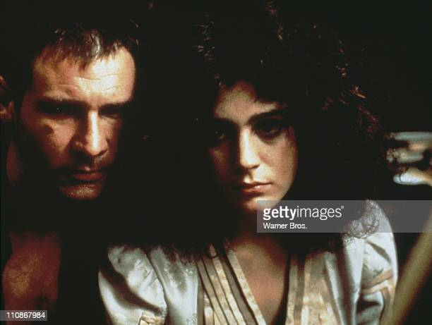 American actors Harrison Ford as Rick Deckard and Sean Young as Rachael in Ridley Scott's futuristic thriller 'Blade Runner' 1982