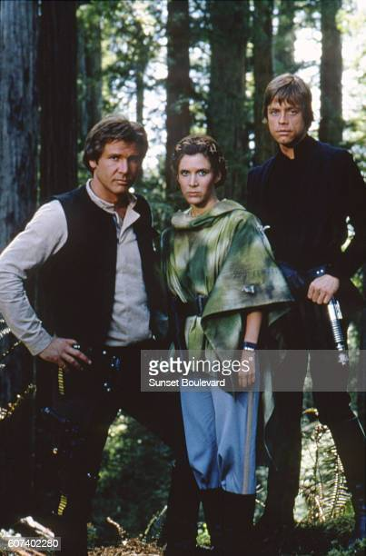 American actors Harrison Ford Carrie Fisher and Mark Hamill on the set of Star Wars Episode VI Return of the Jedi directed by Welsh Richard Marquand