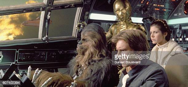 American actors Harrison Ford Carrie Fisher British actors Peter Mayhew and Anthony Daniels on the set of Star Wars Episode V The Empire Strikes Back...