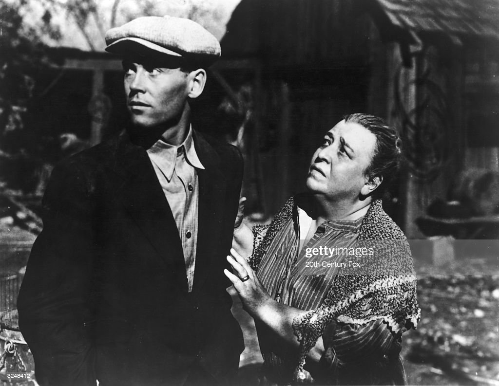 American actors Henry Fonda and Jane Darwell as Ma Joad talk outdoors in a still from the film 'The Grapes of Wrath' directed by John Ford and based...