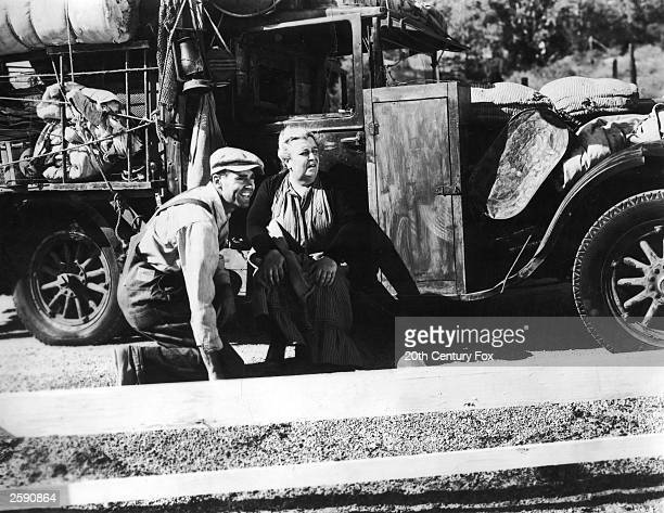 American actors Henry Fonda and Jane Darwell beside a heavily loaded Oakie truck in a still from the film ''The Grapes of Wrath'' directed by John...