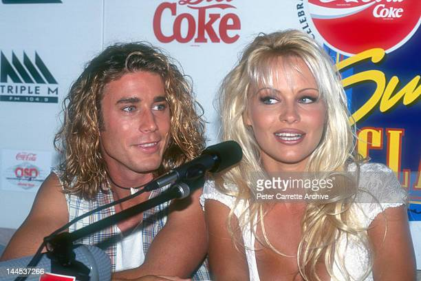 American actors Jaason Simmons and Pamela Anderson who appear in the television show 'Baywatch' attend a press conference to promote the Coca Cola...