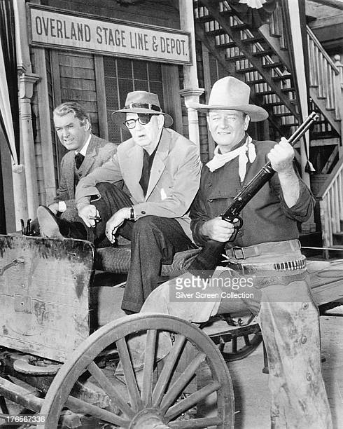 American actors James Stewart and John Wayne with director John Ford on the set of  'The Man Who Shot Liberty Valance' 1962