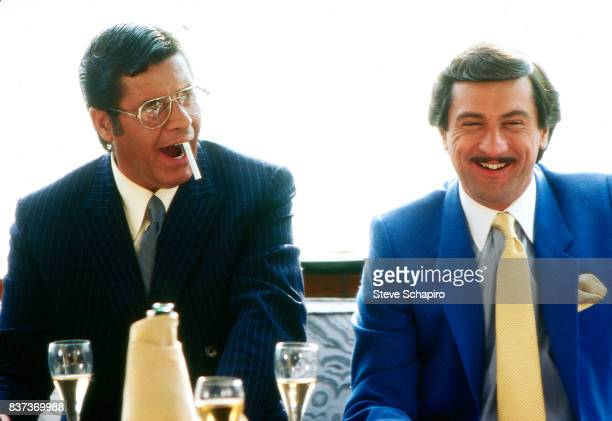 American actors Jerry Lewis and Robert De Niro share a laugh on the set of their film 'The King of Comedy' 1982