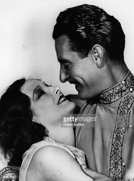American actors John Gilbert and Eleanor Boardman share a romantic moment in the MGM film 'Redemption' directed by Fred Niblo