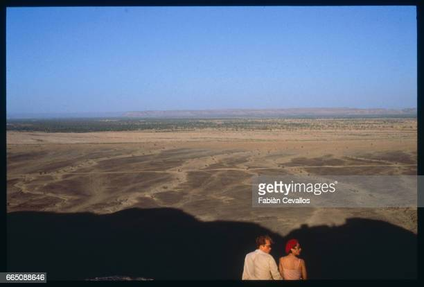 American actors John Malkovitch and Debra Winger in the Moroccan desert during the shooting of the movie Un The au Sahara or Il Te Nel Deserto...