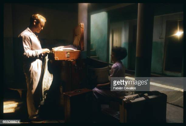 American actors John Malkovitch and Debra Winger unpack in their room during the shooting of the movie Un The au Sahara or Il Te Nel Deserto...