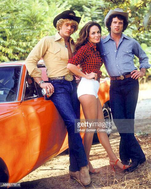 American actors John Schneider Catherine Bach and Tom Wopat in a promotional portrait for the TV show 'The Dukes of Hazzard' circa 1980 They play Bo...