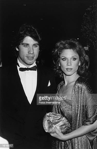 American actors John Travolta and Marilu Henner arrive together at the 37th Annual Golden Globes Awards Beverly Hilton Hotel Beverly Hills California...