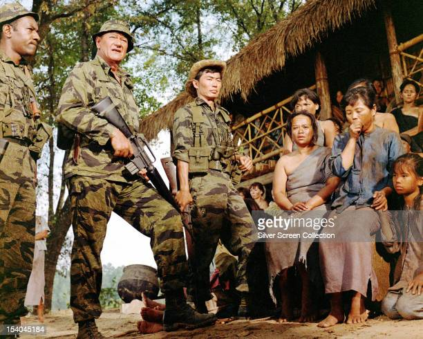American actors John Wayne as Colonel Mike Kirby and George Takei as Captain Nim in 'The Green Berets' directed by John Wayne Ray Kellogg and Mervyn...