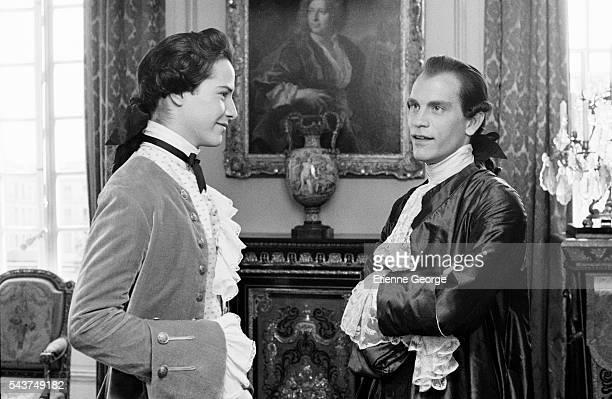 American actors Keanu Reeves and John Malkovich on the set of the film 'Dangerous Liaisons' directed by English director Stephen Frears and based on...
