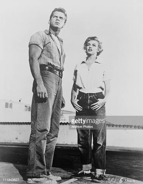 American actors Keith Andes and Marilyn Monroe as Joe Doyle and Mae Doyle D'Amato in a scene from 'Clash By Night' directed by Fritz Lang 1952